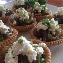 Caramelised onion tartlets with crumbled goats cheese and a balsamic reduction