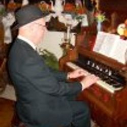 Harry Nulph playing funeral hymns.