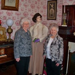 Joan Learish and Lou Arner with Joan's grandmother's wedding ensemble.