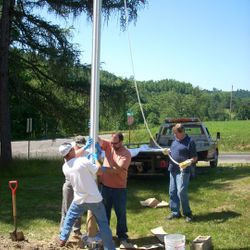 Flag pole installed by volunteers.