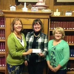 IC Catholic Daughters present $1,000. donation