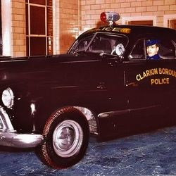 Chief Joe Volpe in Clarion's first police car, a 1946 Olds 66.