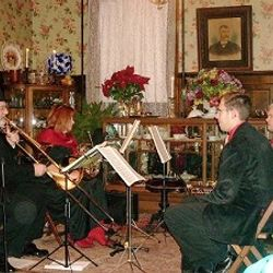 Tom Zeller's Brass Band performing at the CCHS Christmas Open House in the Sutton-Ditz Museum.