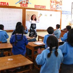 Claudia from Chile working giving religion class to schoolchildren in Cuzco, Peru.