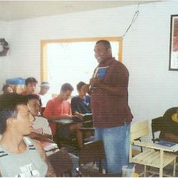Mateo from Fiji working with prisoners.