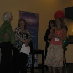 Erin on stage with Barbara Marx Hubbard during her presentation at the Celebrate Your Life conference in Chicago spring of 2012