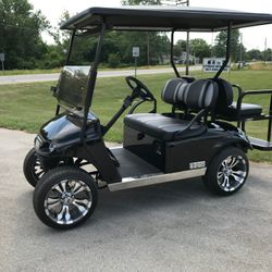 2015 EZGo TXT Gas - Street Legal Light Kit - Custom Wheels and Tires - Extended Roof - Two Tone Seats - Guardian Rear Flip Seat