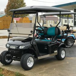 "2015 EZGo TXT Gas - 2"" Lift Kit - Street Legal Light Kit - Two Tone Seats - Guardian Rear Flip Seat - Extended Roof"