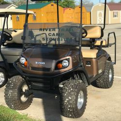 2015 EZGo Express S4 - Lift Kit -  Extended Roof - Headlights/Taillights/Turn Signals - Rear Flip Seat - Woodgrain Dash