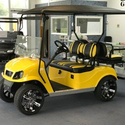"2016 EZGo TXT Gas - Extended Roof - Titan Body - Custom Wheels - Two Tone Seats - Street Legal Light Kit - Guardian Rear Flip Seat - 2"" Lift"