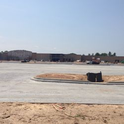 Paving of the new parking lot area in front of Walmart has commenced.