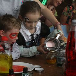 The children getting involved making potions at a Harry Potter party
