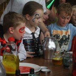 Amazed faces at the 'magic potions' at the Harry Potter party