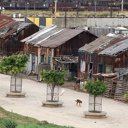 These 3 rusted cottages, originally stemming from the Uitenhage Concentration Camp (circa 1898 - 1902) were earmarked for preservation - but were unfortanately vandalised and eventually fell over due to wheather elements. One of these cottages was  reconstructed within the Red Location Museum (Photo: Annette du Plessis)
