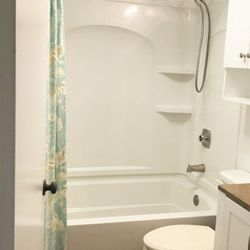 Renovated bathroom with new soaking tub for relaxing.