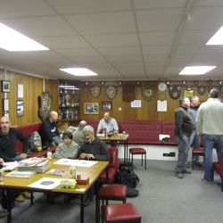 members waiting in the lounge before shooting in the range