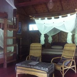 Waterfall Room- King size bed & single bunk beds with mosquito nets.