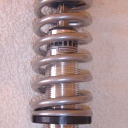 CNC rear shock with chrome look silver spring