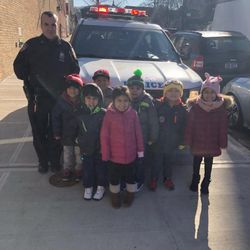 """The officers brought their police car to enhance our unit of study on """"Transportation"""". They let us explore the car and try out the siren. We had lots of fun!"""