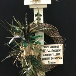 Porch posts can also be used in place of an easel for a sympathy wreath.