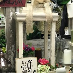 Our wood lanterns look beautiful with a floral arrangement or candles in them.