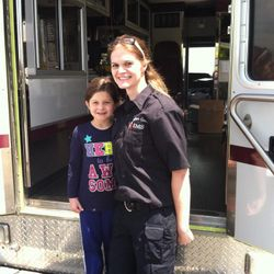 Paramedic Murry visits with local students, teaching them about EMS and safety tips.