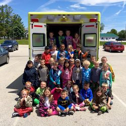 Each year the District visits each elementary school during EMS week to talk to them about safety, and they even get to touch-a-truck!