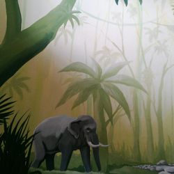The other wall starts with an elephant going to a stream for a drink, whilst a monkey looks on.