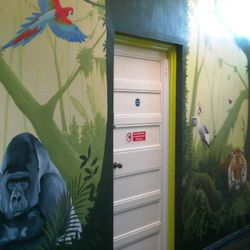 We painted a large tree in the middle to accomodate the door in this middle of this wall.