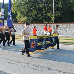 Cadets Elly Powell & Ethan Fowler proudly carry the Unit Banner during the Homecoming Parade Thursday, 14 September 2017 in Downtown Acworth.