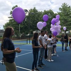 Cadets  holding purple balloons at a Visual Memorial in honor of Ashley Bratton.