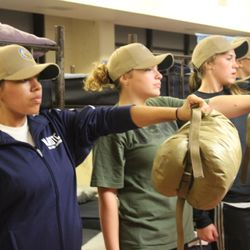 Cadets Nereyda Morales, Faith Anderson & Lilly Dunlap are instructed by Drill Instructors to hold out issued sleep system during BLT at Parris Island, SC 24-27 Oct 2017.