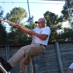 Cadet Corey Tran scales the wall while negotiating an obstacle at the Leadership React Course during BLT at Parris Island, SC 24-27 Oct 2017.
