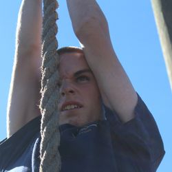 Cadet Paul King displays true grit as he scales the rope climb as he negotiates the obstacle course during BLT at Parris Island, SC 24-27 Oct 2017.