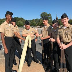 Cadet take a break in between drill routines while competing at Henry County High School's War Hawk Drill Fun Meet, 9 Sep 2017. The Drill Team placed 1st Overall in drill amongst 15 other high schools.