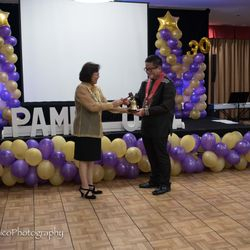 Symbolic Turn Over of Bell & Gravel by Past President, Dr. Shirley Cruzada to Incoming President, Rex Famitangco