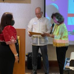 Ms. Rorie Ambat accepting the Certificate of Appreciation on behalf of Ms. Veronica Linder.