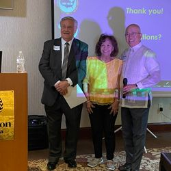 Awarding the Certificate of Appreciation to Dr. Tom Burgess.