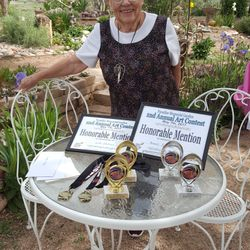 Sponsor Shirley Stanelle with trophies and prizes