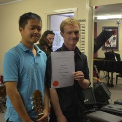 Well done Yiwen! He had a High Distinction in the guitar exam!