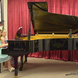 These sisters were playing piano duet 'Swan Lake'