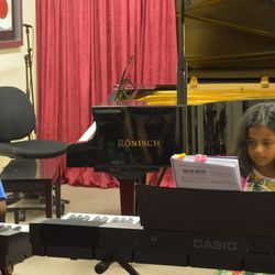 These twins were playing piano duet 'Yankee Doodle' and 'Indians'