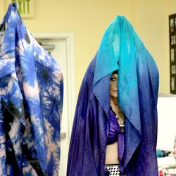 Marjorie Wilson on right peeks through costume during performance with Judy's Gypsies at Paradigm Nursing home in Prospect, CT.