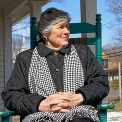 Carol Ann Brown loves sitting on the front porch in her restored historic home in Bethlehem, CT.