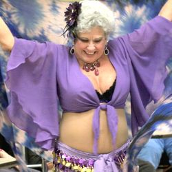 Judy Alt volunteer dances with a troupe of belly dancers in CT.