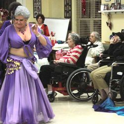 Judy Alt owner of Judy Gypsies, a belly dance troupe  performs at Paradigm Nursing home in Prospect, CT.