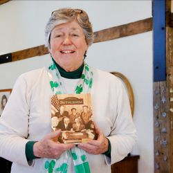 Carol Ann Brown shows her published book, 'Bethlehem' during a visit.