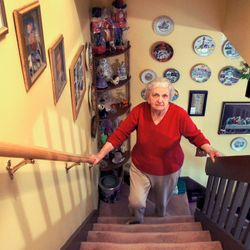 Marie Waage tries to economize her trips up and down the stairs daily, saying they don't present a problem yet.