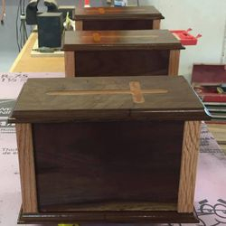 Cremation caskets. Several designs. First caskets were made for friends from a tree from their farm.