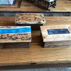 Memory boxes. Different designs. Some have live edge tops, fractal burning, and/or resin pours.